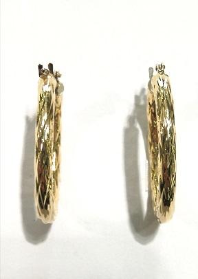 Orecchini anelle ovali  in oro giallo  18 carati rigate  di altezza cm 2,6 larghezza cm 2,0 e spessore mm 2,98